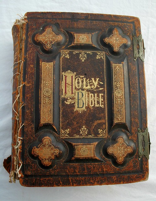 Holy Bible, dated 1885, antique gold lettering, leather and board, held together with dental floss