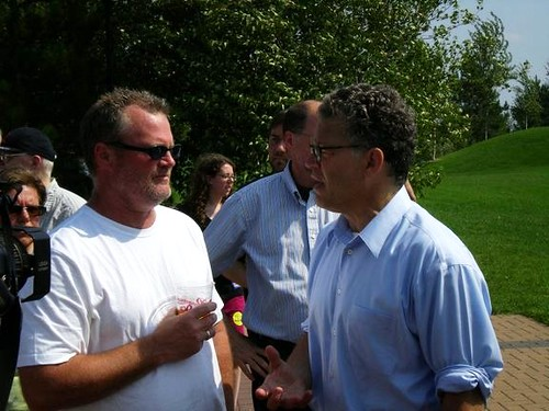 MN: UMD faculty Michael Mullins (UEA) speaks with Al Franken at Labor Day picnic