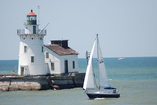 Sail Boat and Lighthouse