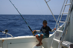 sail(0.0), sailing(0.0), sailing(0.0), mast(0.0), fishing(1.0), vehicle(1.0), sea(1.0), jigging(1.0), big game fishing(1.0),