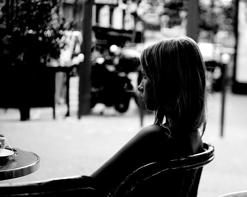 Young Girl at a Sidewalk Café