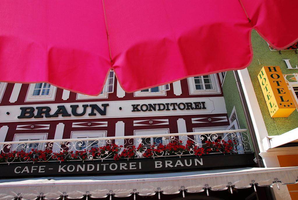 under a pink umbrella