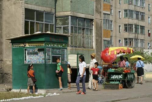 Newspaper kiosk and vegetable stall in Taehak Street, Pyongyang
