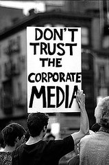 Image of a sign that reads Don't Trust The Corporate Media
