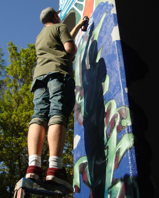 Graffiti artist on column asheville mural project amp for Asheville mural project