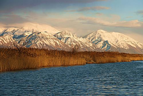 lake snow mountains clouds reeds utah saratogasprings utahlake