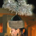 Osh: traditional hat with feathers on a Kyrgyz folk singer