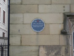 Photo of John Dobson black plaque