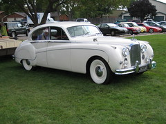 rolls-royce phantom v(0.0), bentley s2(0.0), daimler 250(0.0), jaguar mark 2(0.0), bentley s1(0.0), rolls-royce silver cloud(0.0), bmw 501(0.0), compact car(0.0), jaguar xk150(0.0), automobile(1.0), automotive exterior(1.0), vehicle(1.0), jaguar mark ix(1.0), mid-size car(1.0), jaguar mark vii(1.0), jaguar mark 1(1.0), antique car(1.0), sedan(1.0), classic car(1.0), vintage car(1.0), land vehicle(1.0), luxury vehicle(1.0),