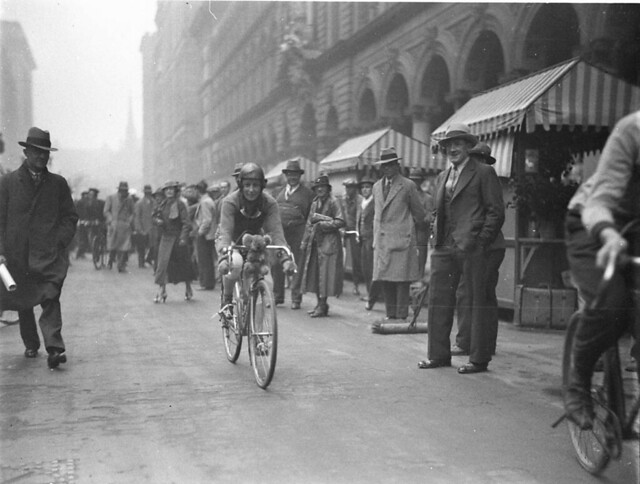 Billie Samuels on a Malvern Star cycle leaving for Melbourne from Martin Place, 4 July 1934, by Sam Hood