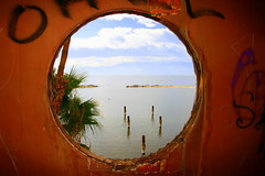 Looking out at the Salton Sea through a porthole