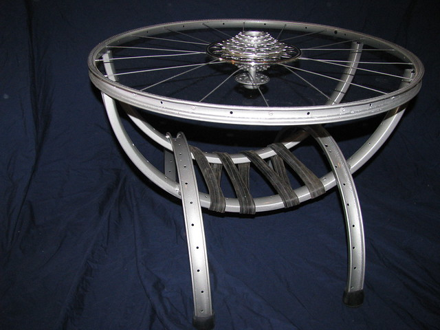 Bike wheel coffee table with magazine holder flickr for Bicycle wheel table