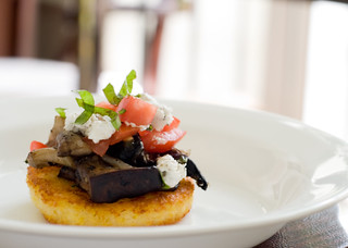Sauteed Cheesy Polenta topped with Wild Mushroom Fricasse and Goat Cheese