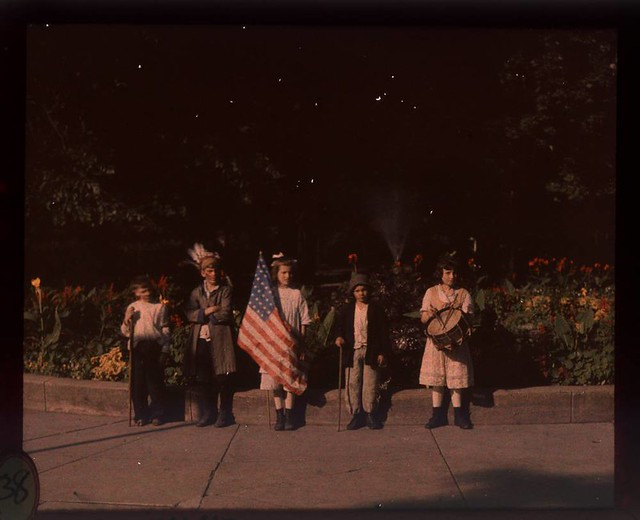 Children in costumes with flags at Jones Park
