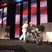 AWEA CEO Denise Bode arrives to General Session riding a custom motorcycle, inspired by wind power, driven by Dave Perewitz, at AWEA WINDPOWER 2011 Conference & Exhibition held at the Anaheim Convention Center on May 23, 2011