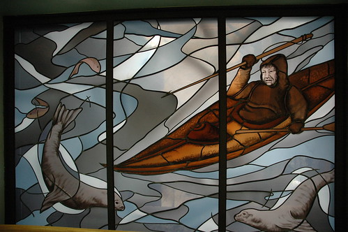 Eskimo man, with harpoon, water and ice, stained glass window, Alaska Pioneer's Home, Anchorage, Alaska