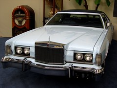 sports car(0.0), automobile(1.0), automotive exterior(1.0), lincoln mark series(1.0), rolls-royce camargue(1.0), vehicle(1.0), performance car(1.0), full-size car(1.0), lincoln continental mark v(1.0), classic car(1.0), land vehicle(1.0), luxury vehicle(1.0), coupã©(1.0),