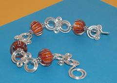 Orange lampwork bracelet