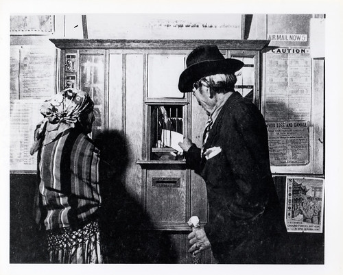 Customers in a Rural Post Office by Smithsonian Institution