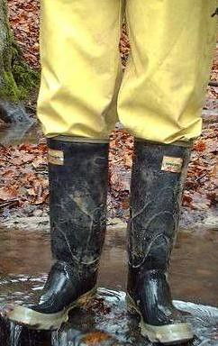 rubber boots and rain suit