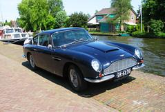 performance car(0.0), convertible(0.0), automobile(1.0), automotive exterior(1.0), vehicle(1.0), aston martin db4(1.0), aston martin db5(1.0), antique car(1.0), classic car(1.0), vintage car(1.0), land vehicle(1.0), sports car(1.0),