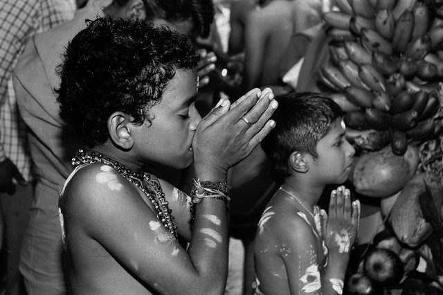 In Prayer, The Solemn Raised Hands of A Young Initiate to Kavady in Kerala India.
