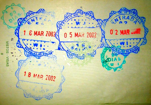 Multiple Bolivia entry stamps in a passport.