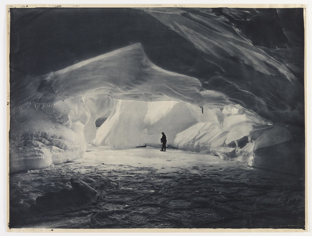 Cavern carved by the sea in an ice wall near Commonwealth Bay, 1911-1914