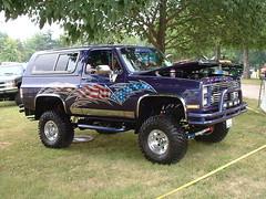 pickup truck(0.0), truck(0.0), automobile(1.0), automotive exterior(1.0), sport utility vehicle(1.0), vehicle(1.0), dodge ramcharger(1.0), compact sport utility vehicle(1.0), off-roading(1.0), bumper(1.0), land vehicle(1.0),