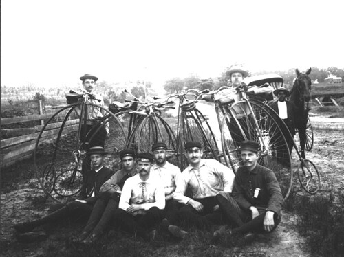 Eight young men with Penny-Farthing bicycles