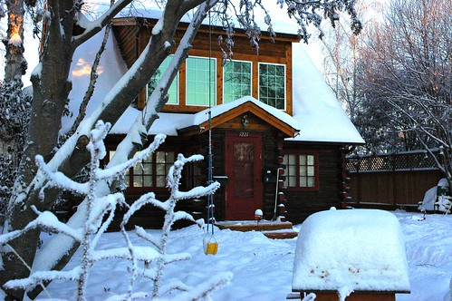 Anchorage old Log Cabin with swing under fresh snow, Alaska, USA