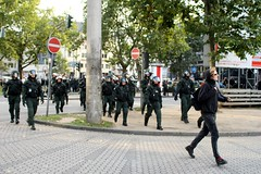 violence(0.0), marching(0.0), demonstration(0.0), protest(0.0), police(1.0), police officer(1.0), military(1.0), person(1.0), pedestrian(1.0),