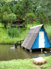 boathouse(0.0), river(0.0), village(1.0), hut(1.0), shack(1.0), cottage(1.0), house(1.0), wilderness(1.0), jungle(1.0), rural area(1.0),