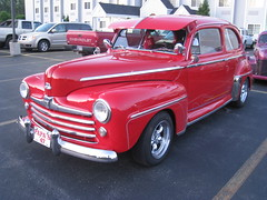 1941 ford(0.0), plymouth deluxe(0.0), sedan(0.0), automobile(1.0), vehicle(1.0), mid-size car(1.0), chevrolet advance design(1.0), compact car(1.0), antique car(1.0), classic car(1.0), land vehicle(1.0), motor vehicle(1.0),
