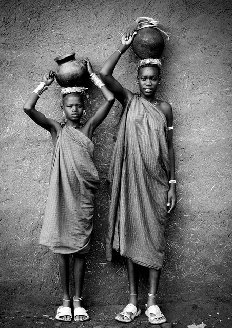 Bodi girls bringing milk Ethiopia