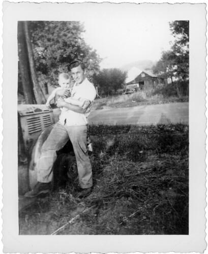 Man with baby on farm L010