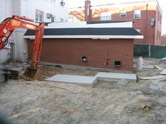 asphalt(0.0), foundation(0.0), demolition(0.0), wood(1.0), roof(1.0), construction equipment(1.0), construction(1.0), brickwork(1.0),