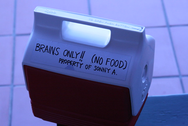 Cooler with the label 'Brains only!!! (No Food). Probably too much cholesterol...