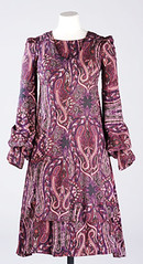 gown(0.0), blouse(0.0), design(0.0), pink(0.0), art(1.0), textile(1.0), magenta(1.0), clothing(1.0), purple(1.0), sleeve(1.0), maroon(1.0), dress(1.0), paisley(1.0),