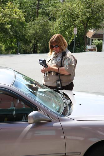 Female officer writing citation
