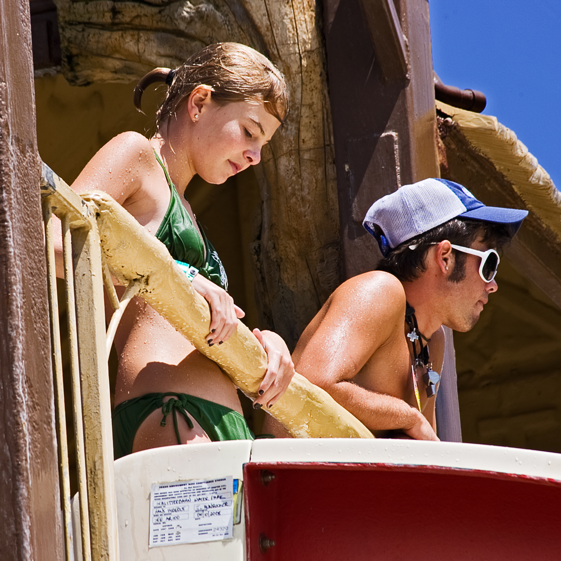 Girl waiting to get into waterslide next to Water Park Attendant1800