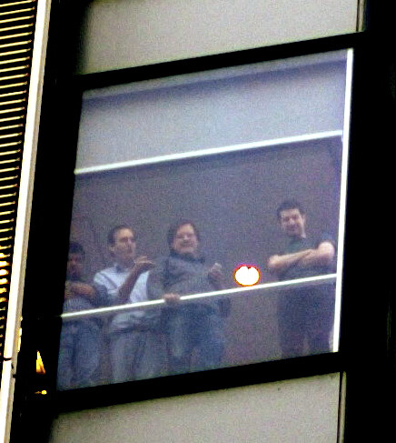 NYTD developers watch crowd from 8th floor