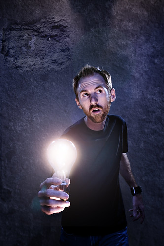 Holding a lightbulb. Stephen Poff.