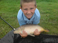 Kyle with a 9lb 3oz mirror. Caught 7th August from Moss Lake on Tutti Fuitti boilie topped with plastic corn.