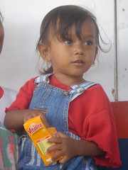 "little girl receiving multimicronutrient Sprinkles ""Vitalita"" (local name of sprinkles) in temporary shelter in Tsunami affected areas in Banda Aceh, Indonesia"