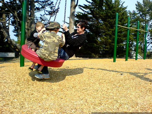 rachel and her boys on the tire swing   DSC01251