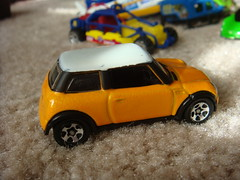 model car, automobile, mini cooper, automotive exterior, yellow, vehicle, mini, land vehicle, toy,