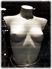 Naked mannequin showing tits