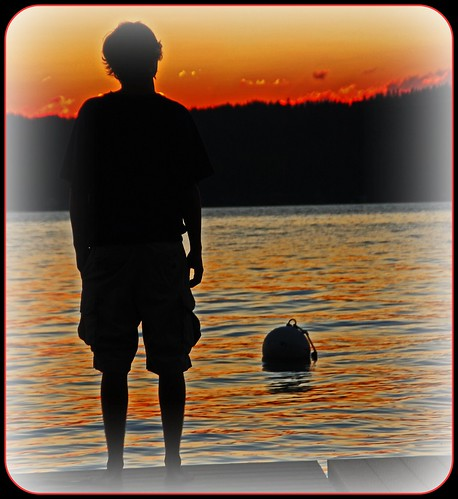 sunset red man water gold dock young orage buoy reflectionsilhouette