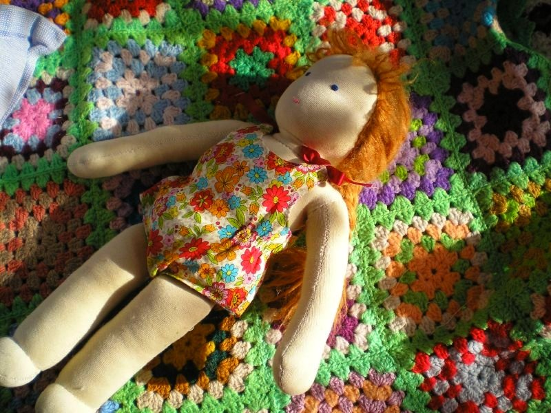 Sweet Amelia, the oldest doll, sunbaking
